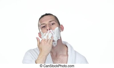 Mornings procedure Man gets shaving aid on face White...