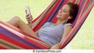 Pretty young woman relaxing in a hammock - Pretty young...