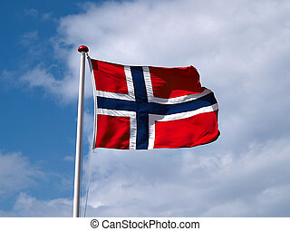 Waiving flag of Norway with partly cloudy blue sky...