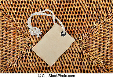 Empty tag on wickered background - Empty paper tag on...