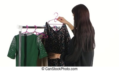 Female shopping for clothing at store. White