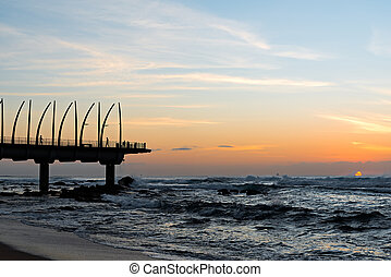 View of the Indian Ocean through the Millennium Pier in...