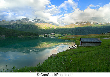 view of a mountain lake in Engadin valley in the summer time