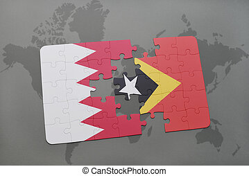 puzzle with the national flag of bahrain and east timor on a world map background.