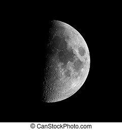 First quarter moon seen with an astronomical telescope (seen...