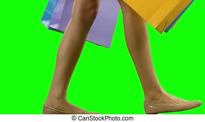 Woman holding shopping-bags and walking Green screen - Woman...