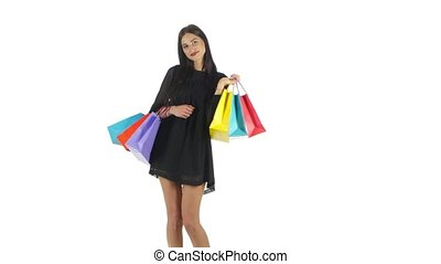 Shopping woman holding shopping bags. White