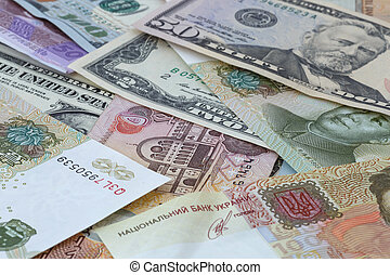 several currencies banknotes - heap of several currencies...