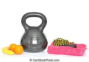 Isolated kettlebell, ab wheel and jumping rope on white...