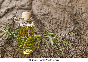 Essential oils of osemary in glass jar