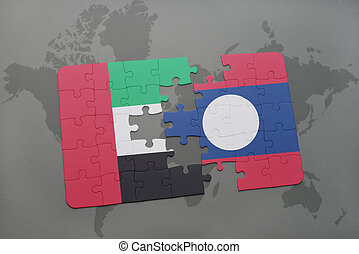puzzle with the national flag of united arab emirates and laos on a world map background.
