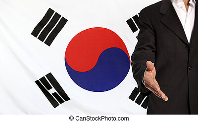 Open hand and South Korea flag in the background -...