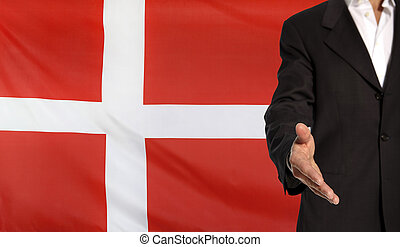 Open hand and Denmark flag in the background - Businessman...