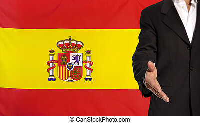 Open hand and Spain flag in the background - Businessman...