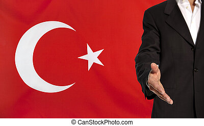 Open hand and Turkey flag in the background - Businessman...