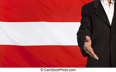 Open hand and Austria flag in the background - Businessman...