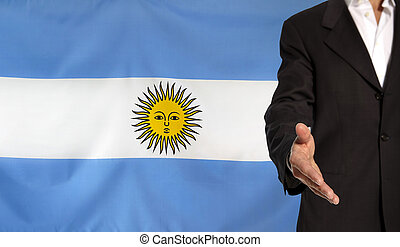 Open hand and Argentina flag in the background - Businessman...