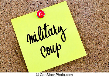Written text Military Coup over yellow paper note pinned on...