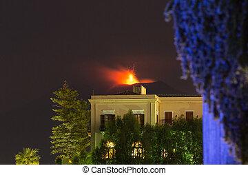 Eruption of Sicilian volcano Etna at night, seen from...