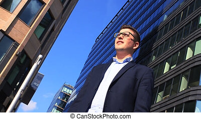 Portrait of an handsome businessman in an urban setting HD