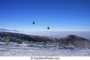 Cable car ski lift over mountain landscape - Cable car over...