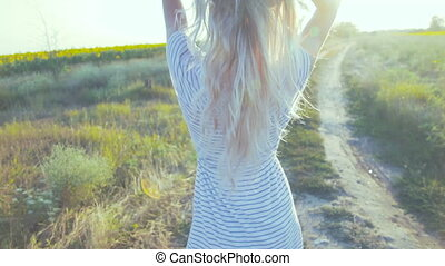 Young woman on country road. The style of film. Blur lens....