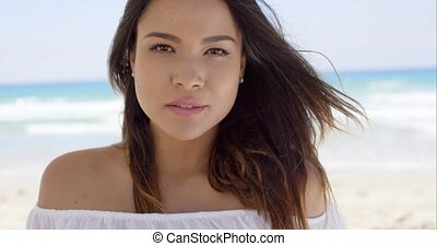 Gorgeous young woman relaxing on the beach