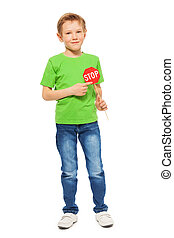 Schoolboy with small Stop sign in his hand