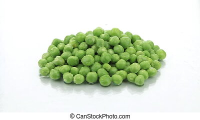 Zoom heap of ripe, fresh green peas in the drops of dew