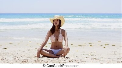 Pretty young woman relaxing on a tropical beach - Pretty...
