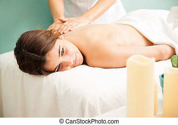 Getting a back massage at the spa