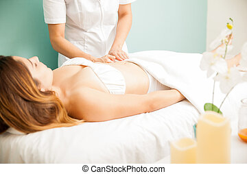Woman getting deep tissue massage - Profile view of a young...