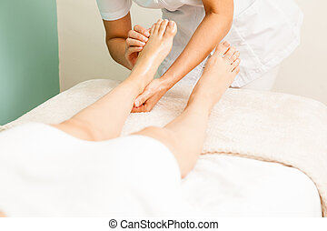Woman on a reflexology session at the spa