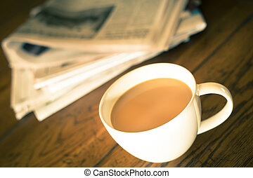 coffee newspaper morning - Vintage toned image of Cup of...