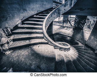 Spiral staircase in the ruined and abandoned hotel on Sao...