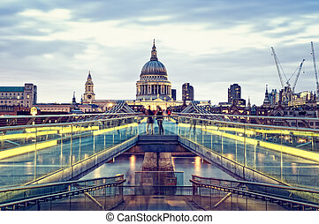 St Paul\'s Cathedral and Millennium Bridge at night.