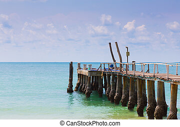 Fishing jetty over seacoast skyline, natural landscape...