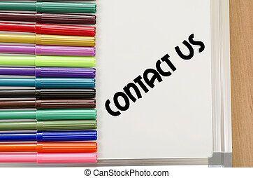 Contact us concept - Contact us written on whiteboard over...