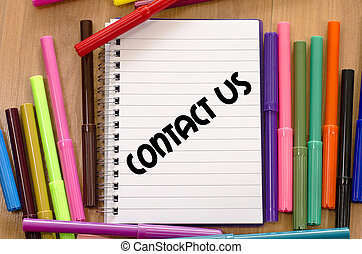 Contact us concept - Contact us written on notebook over...