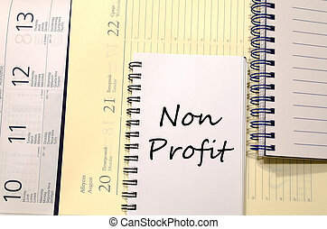Non profit write on notebook - Non profit text concept write...