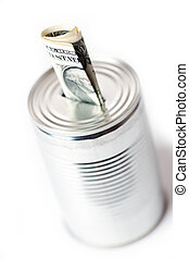 paper currency in tin can - photo shot of paper currency in...
