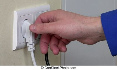 Hand Put Plug Into Electricity Socket - Hand Putting Plug...