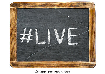 live hashtag handwritten on vintage school slate board...