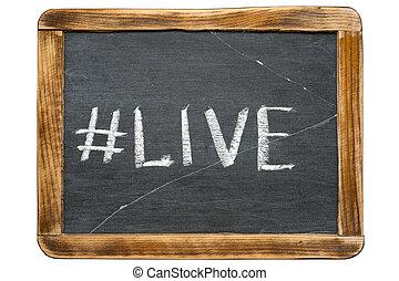 live hashtag handwritten on vintage school slate board...