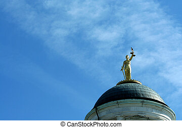 Lady Justice statue against blue sky - A Lady Justice statue...