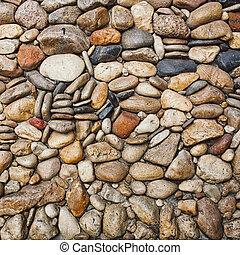 Sea stones pebble texture background .
