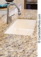 Modern Stainless Steel Faucet on Granite Kitchen Counter