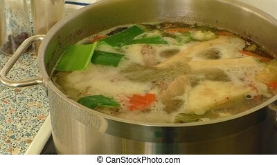 Chicken soup on the stove