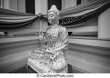 Black and white Buddha statue in Thai temple