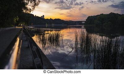 4K hyperlapse of summer evening park, river and pedestrian...